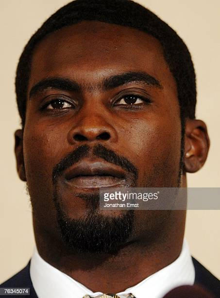 Atlanta Falcons quarterback Michael Vick makes a statement to reporters at the Omni Richmond Hotel after agreeing to a guilty plea on charges...