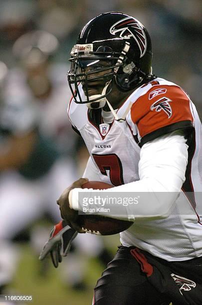 Atlanta Falcons quarterback Michael Vick runs out of the pocket against the Philadelphia Eagles at Lincoln Financial Field in Philadelphia...