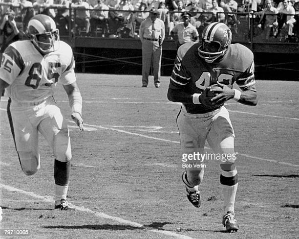 Atlanta Falcons running back Dave Hampton on a carry while being chases down by Los Angfeles Rams Hall of Fame defensive end Jack Youngblood in a 313...