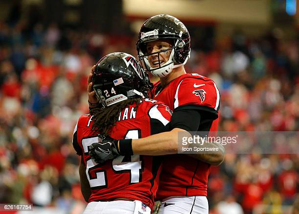 Atlanta Falcons running back Devonta Freeman celebrates a touchdown with quarterback Matt Ryan during an NFL football game between the Arizona...