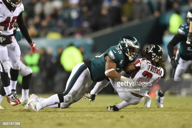 Atlanta Falcons running back Devonta Freeman is tackled for a loss by Philadelphia Eagles defensive end Brandon Graham during the NFC Divisional...