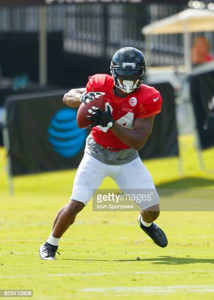 Atlanta Falcons running back Devonta Freeman takes part of a drill on August 01 2017 during the Atlanta Falcons Training Camp in Flowery Branch Ga