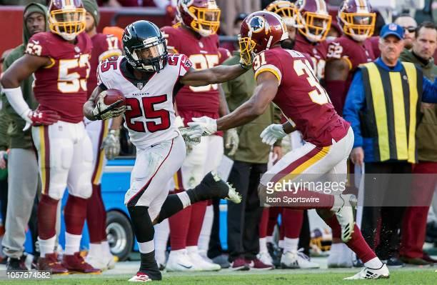 Atlanta Falcons running back Ito Smith stiff arms Washington Redskins cornerback Fabian Moreau during a NFL game between the Washington Redskins and...