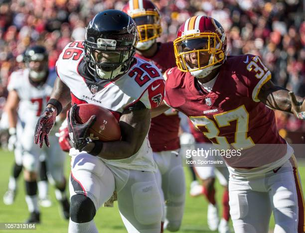 Atlanta Falcons running back Tevin Coleman bursts past Washington Redskins cornerback Greg Stroman for a first quarter touchdown during a NFL game...