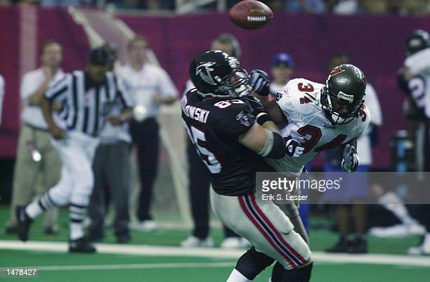 Atlanta Falcons tight end Brian Kozlowski fumbles the ball after getting jarred by Tampa Bay Buccaneers safety Dexter Jackson in the second half on...