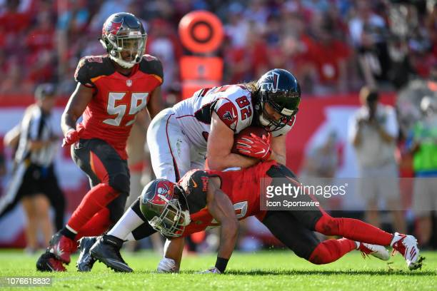 Atlanta Falcons tight end Logan Paulsen is tackled as Tampa Bay Buccaneers linebacker Devante Bond looks on during the second half of an NFL game...