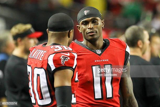 Atlanta Falcons wide receiver Julio Jones and Atlanta Falcons cornerback Deji Olatoye on the sideline late in the fourth quarter of the NFC...