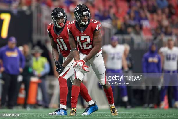 Atlanta Falcons wide receiver Julio Jones and Atlanta Falcons wide receiver Mohamed Sanu look on during an NFL football game between the Minnesota...