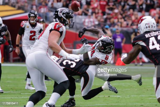 Atlanta Falcons wide receiver Julio Jones has the ball knocked loose by Arizona Cardinals cornerback Byron Murphy during the NFL football game...