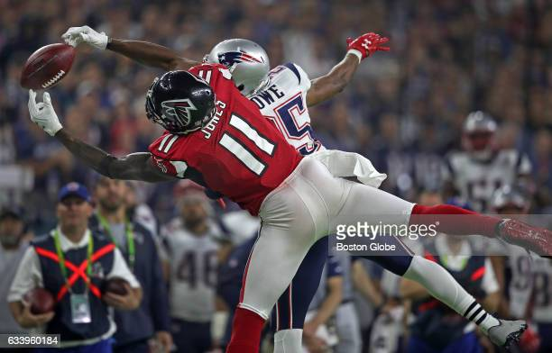 Atlanta Falcons wide receiver Julio Jones makes a catch against New England Patriots defensive back Eric Rowe in the fourth quarter to gave Atlanta a...