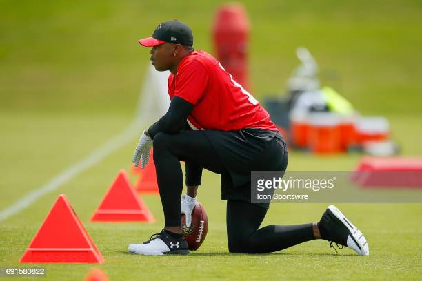 Atlanta Falcons wide receiver Julio Jones watches on during a football practice in Flowery Branch Ga