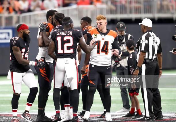 Atlanta Falcons wide receiver Mohamed Sanu and Cincinnati Bengals quarterback Andy Dalton greet each other before the NFL game between the Cincinnati...