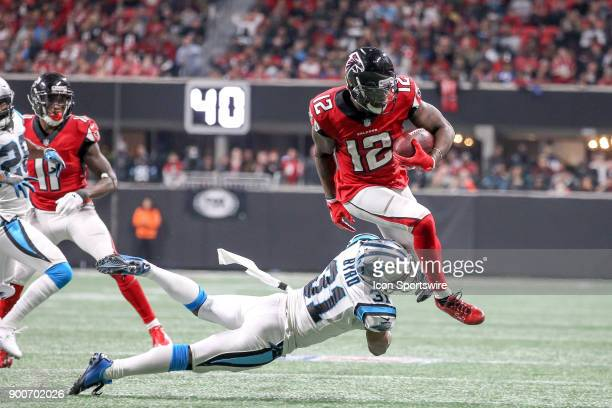 Atlanta Falcons wide receiver Mohamed Sanu breaks a tackle during the NFL game between the Carolina Panthers and the Atlanta Falcons on December 31...