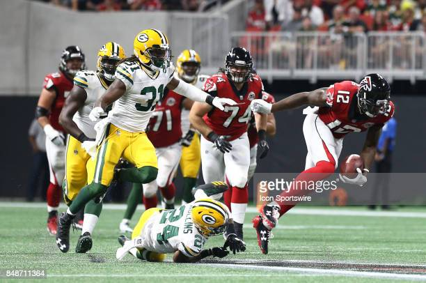 Atlanta Falcons wide receiver Mohamed Sanu breaks a tackle for a first down during the first half of the NFL game between the Green Bay Packers and...