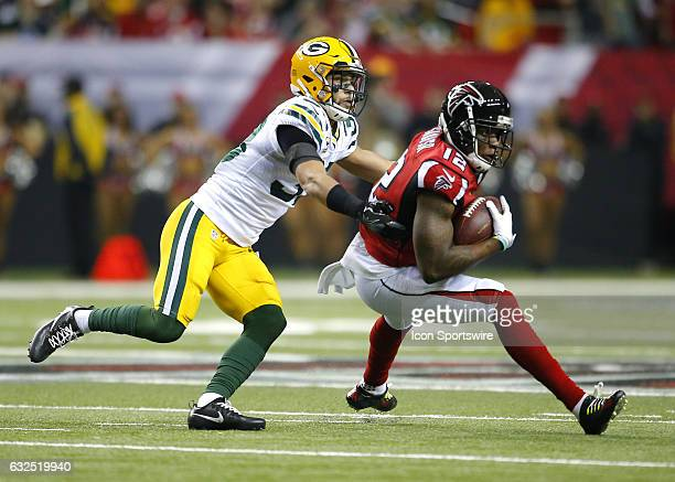 Atlanta Falcons wide receiver Mohamed Sanu is tackled by Green Bay Packers strong safety Micah Hyde in the first half of the NFC Championship game...