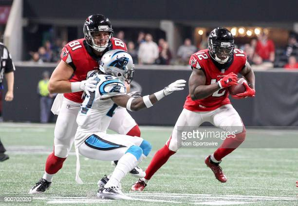 Atlanta Falcons wide receiver Mohamed Sanu runs the ball for a first down during the NFL game between the Carolina Panthers and the Atlanta Falcons...