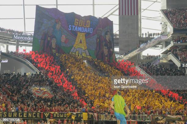 Atlanta fans roll out a tifo prior to the start of the match between Atlanta and Seattle on July 15th 2018 at MercedesBenz Stadium in Atlanta GA...