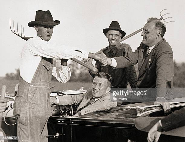 Atlanta GA Governor Franklin D Roosevelt of New York has stressed helping the farmer in quite a few of his campaign speeches and here he is getting...