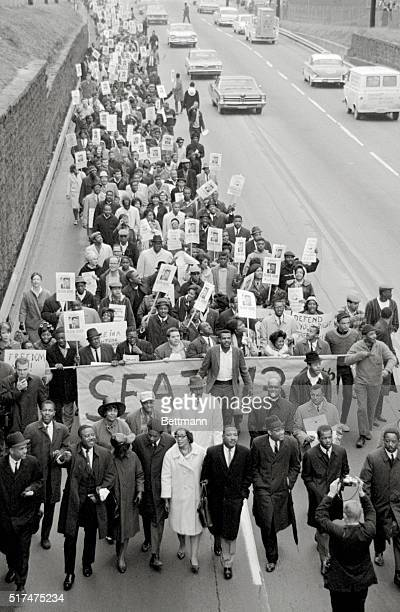 Dr Martin Luther King with his wife lead a march of about 800 to the Georgia capitol to protest the ousting of State Representativeelect Julian Bond...