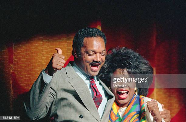 Jesse Jackson gives a thumbs up sign as he enjoys his appearance on stage with an equally happy Oprah Winfrey at a salute for Jackson at a downtown...
