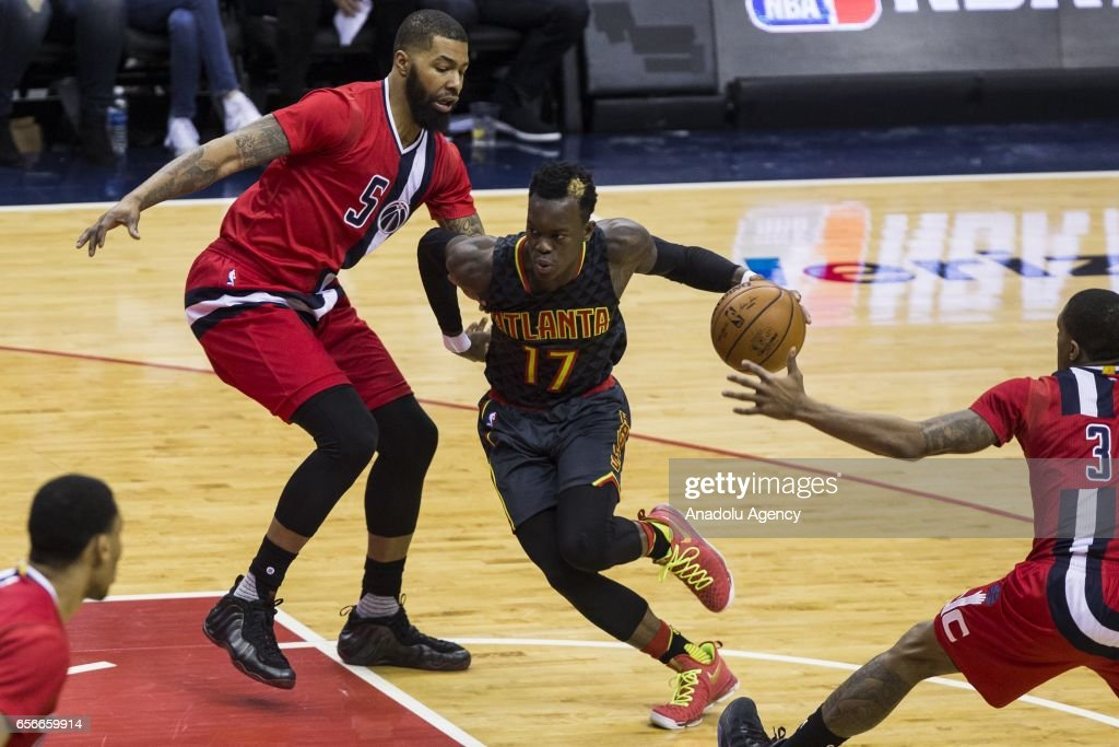 Atlanta Hawk Dennis Schroder (17) dribbles past Washington Wizard Markieff Morris (5) at the Verizon Center in Washington, USA on March 22, 2017. Atlanta leads Washington 46-40 at halftime.