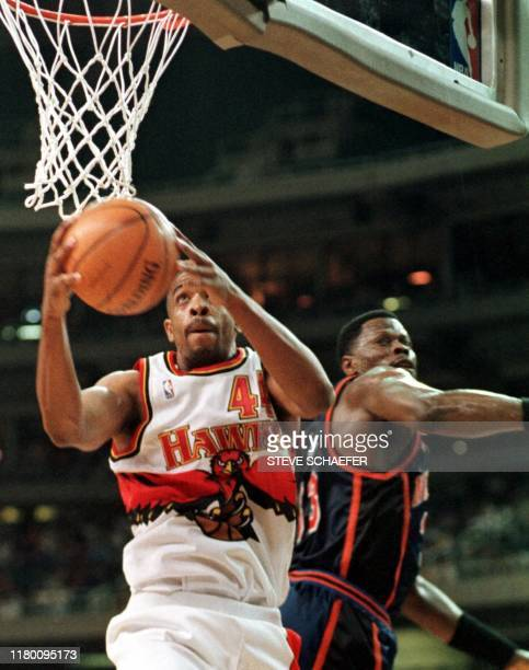Atlanta Hawks Alan Henderson takes a shot while being guarded by New York Knicks Patrick Ewing during their game 09 April 1999 in Atlanta Georgia The...