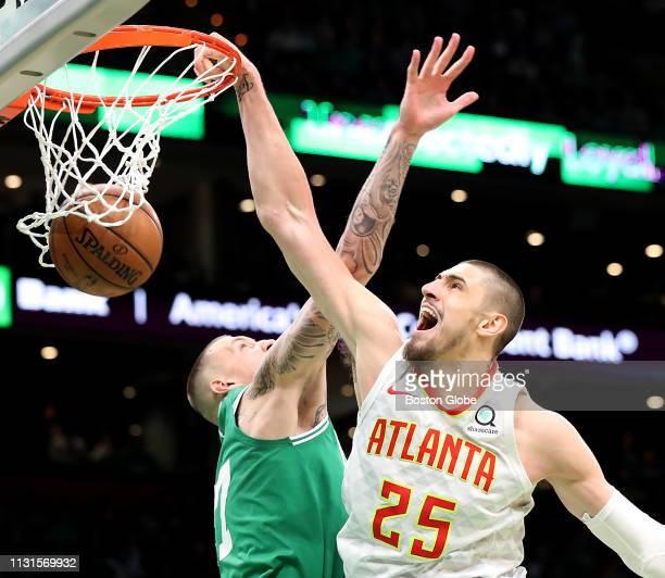 Atlanta Hawks' Alex Len slam dunks over Boston Celtics' Daniel Theis during the third quarter The Boston Celtics host the Atlanta Hawks in a regular...