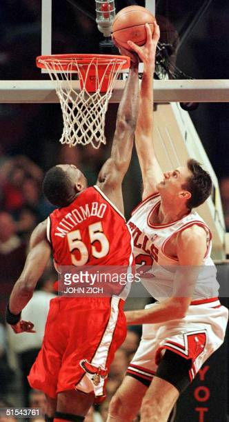 Atlanta Hawks' center Kikembe Mutombo blocks a shot by Chicago Bulls' center Chris Anstey in the first half 07 March 2000 at the United Center in...