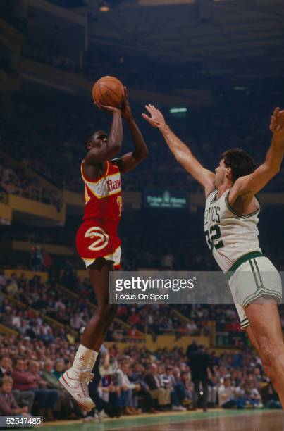 Atlanta Hawks' Dominique Wilkins takes a jumpshot as Boston Celtics' Kevin McHale during a game at the Boston Garden circa 1980's in Boston...