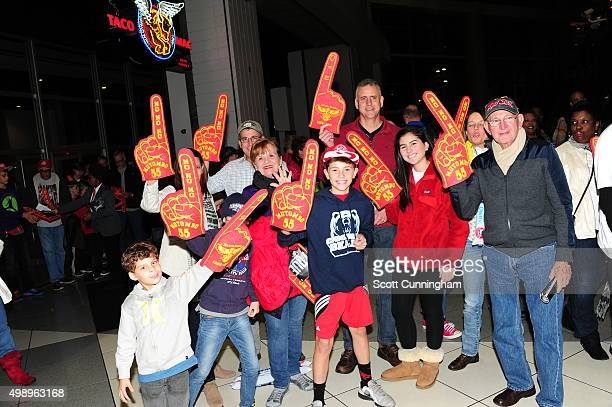 Atlanta Hawks fans pose for a photo before the game against the Boston Celtics on November 24 2015 at Philips Arena in Atlanta Georgia NOTE TO USER...
