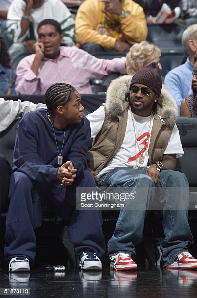 Atlanta Hawks fans producer Jermaine Dupri and rapper Bow Wow watch from the sideline during the game against the Miami Heat November 24 2004 at...