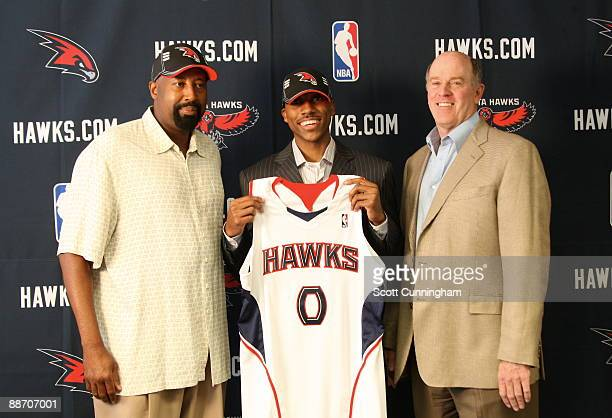 Atlanta Hawks first round draft pick Jeff Teague poses for a photo with Head Coach Mke Woodson and GM Rick Sund at a press conference on June 26 2009...
