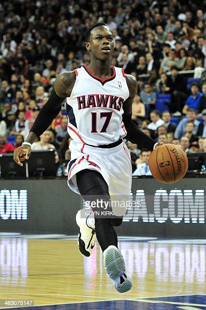 Atlanta Hawks' German player Dennis Schroder dribbles the ball forward during the NBA Global Games London 2014 basketball match between Atlanta Hawks...