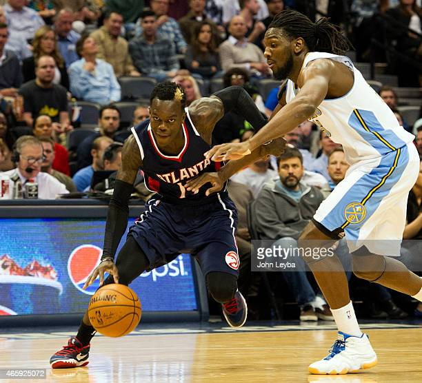 Atlanta Hawks guard Dennis Schroder drives on Denver Nuggets forward Kenneth Faried during the first quarter March 11 2015 at Pepsi Center