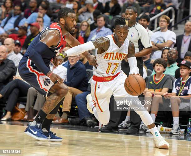 Atlanta Hawks guard Dennis Schroder drives to the basket around Washington Wizards guard John Wall during Game four of the Eastern Conference...
