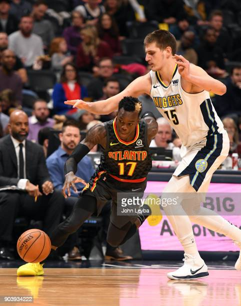 Atlanta Hawks guard Dennis Schroder drives under the arm of Denver Nuggets center Nikola Jokic during the second quarter on January 10 2018 at Pepsi...