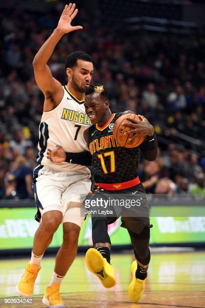Atlanta Hawks guard Dennis Schroder gets a bump from Denver Nuggets forward Trey Lyles as he drives to the basket during the second quarter on...