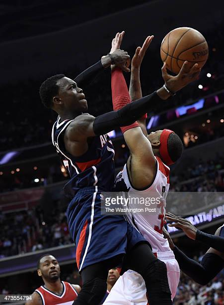 Atlanta Hawks guard Dennis Schroder goes up against Washington Wizards forward Paul Pierce on his way to the basket during the second half of game 6...