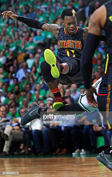 Atlanta Hawks guard Dennis Schroder sails over the back of Boston Celtics guard Isaiah Thomas in the second half of Game 3 in the Eastern Conference...