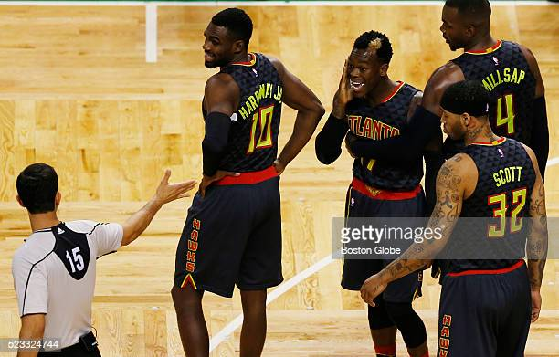 Atlanta Hawks guard Dennis Schroder second player from left reacts to Boston Celtics guard Isaiah Thomas as the two exchange words during the first...