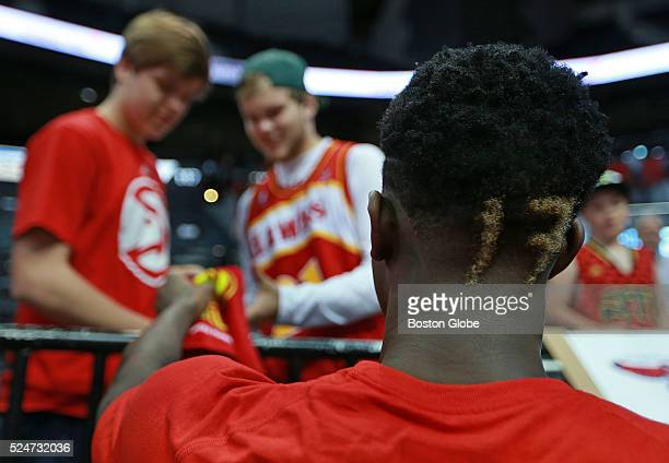 Atlanta Hawks guard Dennis Schroder signs autographs for some young fans before Game 5 against the Boston Celtics in the first round of the Eastern...