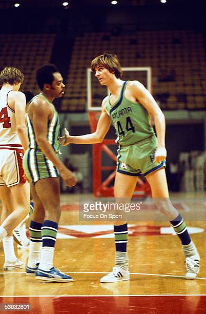 Atlanta Hawks' guard Pete Maravich congratulates a teammate by patting him on the chest. NOTE TO USER: User expressly acknowledges and agrees that,...