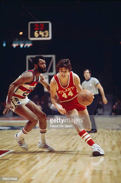 Atlanta Hawks' guard Pete Maravich dribbles downcourt against the Washington Bullets at Capital Centre circa the 1970's in Washington DC NOTE TO USER...