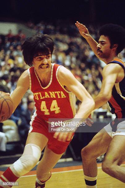 Atlanta Hawks' guard Pete Maravich dribbles near the net during a game NOTE TO USER User expressly acknowledges and agrees that by downloading and/or...