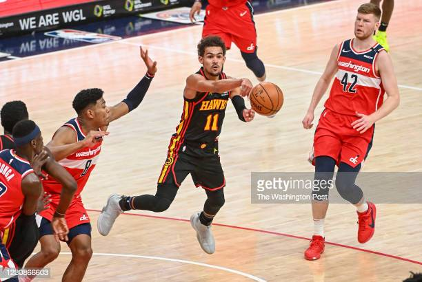 Atlanta Hawks guard Trae Young dishes out to the wing on the final play of the first half against the Washington Wizardsat Capital One Arena.