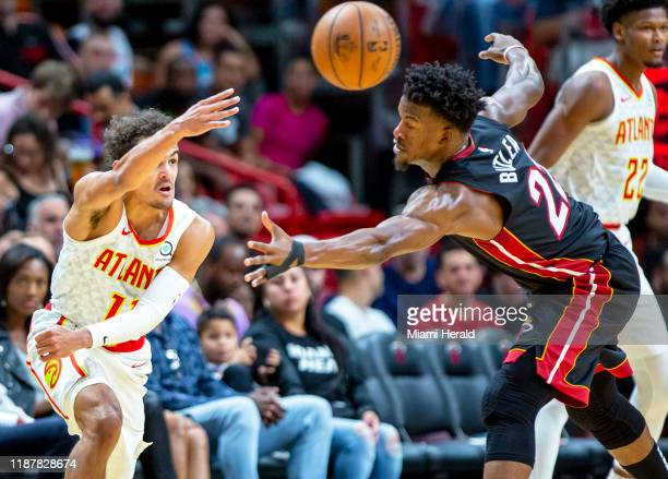 Atlanta Hawks guard Trae Young passes the ball over Miami Heat forward Jimmy Butler during the first quarter on Tuesday, Dec. 10, 2019 at...