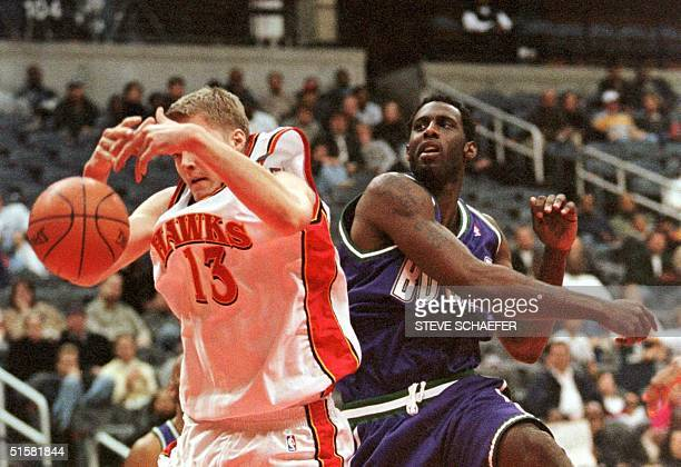 Atlanta Hawks Hanno Mottola and Milwaukee Bucks Tim Thomas fight for a rebound during their game in Atlanta Georgia 02 December 2000 The Hawks beat...