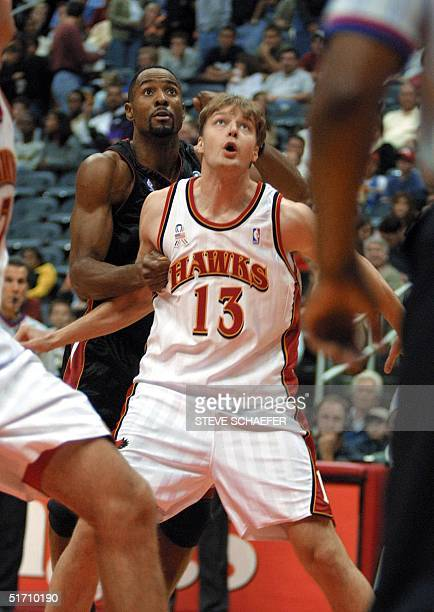 Atlanta Hawks Hanno Mottola blocks Miami Heats Alonzo Mourning at Philips Arena 03 November 2001 in Atlanta GA The Hawks beat the Heat 9083 AFP PHOTO...