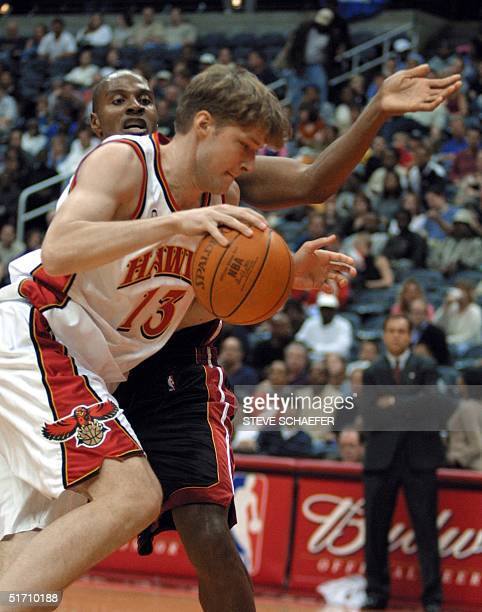 Atlanta Hawks Hanno Mottola drives by Miami Heats Eddie Laphonso Ellis at Philips Arena 03 November 2001 in Atlanta The Hawks beat the Heat 9083 AFP...