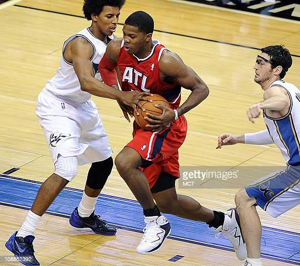 Atlanta Hawks shooting guard Joe Johnson drives between Washington Wizards shooting guard Nick Young right and guard Kirk Hinrich during the third...